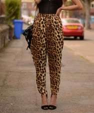 ... she's wearing those leopard-print pants common with Eastlands chics ...